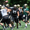 "Tyler Hicks, 9, makes a pass in traffic during the University of Colorado Football team practice on Friday August 12, 2011.<br /> For more photos and video interviews from the practice go to  <a href=""http://www.buffzone.com"">http://www.buffzone.com</a> and dailycamera.com<br /> Photo by Paul Aiken  August 12,  2011."