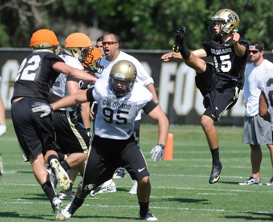 """Punter Zach Grossnickle, 15, during the University of Colorado Football team practice on Friday August 12, 2011.<br /> For more photos and video interviews from the practice go to  <a href=""""http://www.buffzone.com"""">http://www.buffzone.com</a> and dailycamera.com<br /> Photo by Paul Aiken  August 12,  2011."""