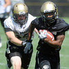 "Kennan Canty, 4, runs away from Jon Major, 31, in a passing drill during the University of Colorado Football team practice on Friday August 12, 2011.<br /> For more photos and video interviews from the practice go to  <a href=""http://www.buffzone.com"">http://www.buffzone.com</a> and dailycamera.com<br /> Photo by Paul Aiken  August 12,  2011."