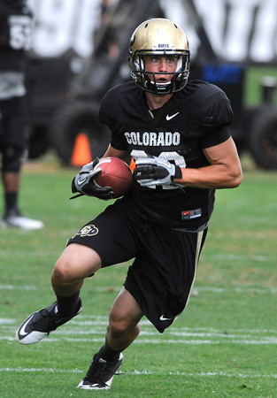 "Tony Jones, 32, breaks down the field after making a catch during the University of Colorado afternoon practice on the Boulder Campus on Tuesday. FOR MORE PHOTOS A VIDEO INTERVIEW FROM THE PRACTICE GO TO  <a href=""http://WWW.DAILYCAMERA.COM"">http://WWW.DAILYCAMERA.COM</a><br /> Photo by Paul Aiken / The Camera / 8/ 16/ 11"