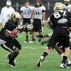 "Malcolm Carter, 44, gets a block from Tyler McCulloch, 87, on Terrel Smith, 41, during the University of Colorado afternoon practice on the Boulder Campus on Tuesday. FOR MORE PHOTOS A VIDEO INTERVIEW FROM THE PRACTICE GO TO  <a href=""http://WWW.DAILYCAMERA.COM"">http://WWW.DAILYCAMERA.COM</a><br /> Photo by Paul Aiken / The Camera / 8/ 16/ 11"