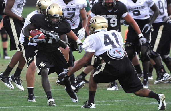 "D.D. Goodson, 21, prepares for contact with Terrel Smith, 41, during the University of Colorado afternoon practice on the Boulder Campus on Tuesday. FOR MORE PHOTOS A VIDEO INTERVIEW FROM THE PRACTICE GO TO  <a href=""http://WWW.DAILYCAMERA.COM"">http://WWW.DAILYCAMERA.COM</a><br /> Photo by Paul Aiken / The Camera / 8/ 16/ 11"