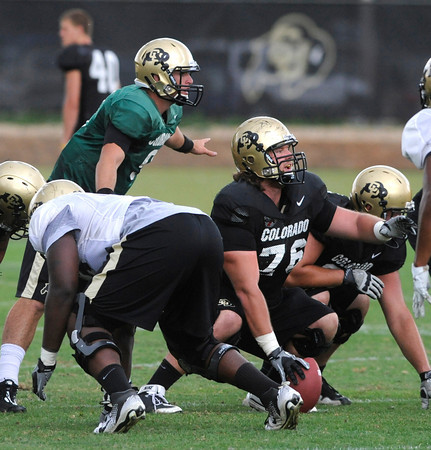 "Quarterback Tyler Hansen, 9, and Gus Handler, 76, call out the defensive adjustment they see during the University of Colorado afternoon practice on the Boulder Campus on Tuesday. FOR MORE PHOTOS A VIDEO INTERVIEW FROM THE PRACTICE GO TO  <a href=""http://WWW.DAILYCAMERA.COM"">http://WWW.DAILYCAMERA.COM</a><br /> Photo by Paul Aiken / The Camera / 8/ 16/ 11"