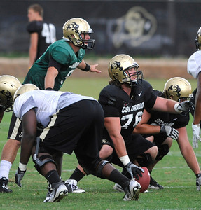 Quarterback Tyler Hansen, 9, and Gus Handler, 76, call out the defensive adjustment they see during the University of Colorado afternoon practice on the Boulder Campus on Tuesday. FOR MORE PHOTOS A VIDEO INTERVIEW FROM THE PRACTICE GO TO WWW.DAILYCAMERA.COM Photo by Paul Aiken / The Camera / 8/ 16/ 11