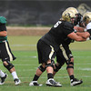 "Quarterback Tyler Hansen, 9, drops back to pass and Gus Handler, 76, blocks Curtis Cunningham, 50, during the University of Colorado afternoon practice on the Boulder Campus on Tuesday. FOR MORE PHOTOS A VIDEO INTERVIEW FROM THE PRACTICE GO TO  <a href=""http://WWW.DAILYCAMERA.COM"">http://WWW.DAILYCAMERA.COM</a><br /> Photo by Paul Aiken / The Camera / 8/ 16/ 11"