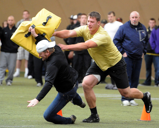 "Nate Solder puts a big hit of Denver Broncos scout, and former CU linebacker, Matt Russell, during an O-line drill.<br /> National Football League scouts came to the CU campus to  test former CU football players for the NFL draft. For a video and photos of the workout, go to  <a href=""http://www.dailycamera.com"">http://www.dailycamera.com</a>.<br /> Cliff Grassmick/ March 9, 2011"