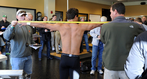 "NFL scouts measure the wing span of Scotty McKnight.<br /> National Football League scouts came to the CU campus to  test former CU football players for the NFL draft. For a video and photos of the workout, go to  <a href=""http://www.dailycamera.com"">http://www.dailycamera.com</a>.<br /> Cliff Grassmick/ March 9, 2011"