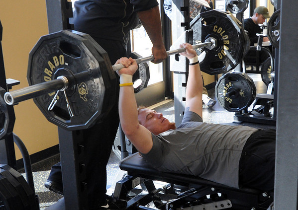 """B.J. Beatty does reps on the bench press for the scouts.<br /> National Football League scouts came to the CU campus to  test former CU football players for the NFL draft. For a video and photos of the workout, go to  <a href=""""http://www.dailycamera.com"""">http://www.dailycamera.com</a>.<br /> Cliff Grassmick/ March 9, 2011"""
