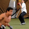 "New York Jets  quarterback, Mark Sanchez,throws to Scotty McKnight  during receiver drills. McKnight and Sanchez are long time friends.<br /> National Football League scouts came to the CU campus to  test former CU football players for the NFL draft. For a video and photos of the workout, go to  <a href=""http://www.dailycamera.com"">http://www.dailycamera.com</a>.<br /> Cliff Grassmick/ March 9, 2011"