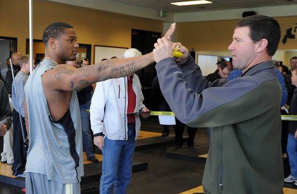 """NFL scouts measure the hands of Jimmy Smith.<br /> National Football League scouts came to the CU campus to  test former CU football players for the NFL draft. For a video and photos of the workout, go to  <a href=""""http://www.dailycamera.com"""">http://www.dailycamera.com</a>.<br /> Cliff Grassmick/ March 9, 2011"""