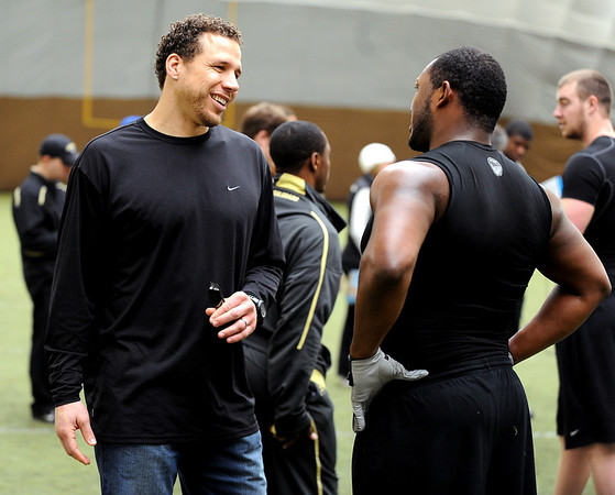 Former Buff and NFL player, Chad Brown, talks to Marcus Burton.<br /> University of Colorado football players eligible for the NFL Draft showed their skills during  pro-timing day on campus  on Wednesday.<br /> Cliff Grassmick / March 10, 2010