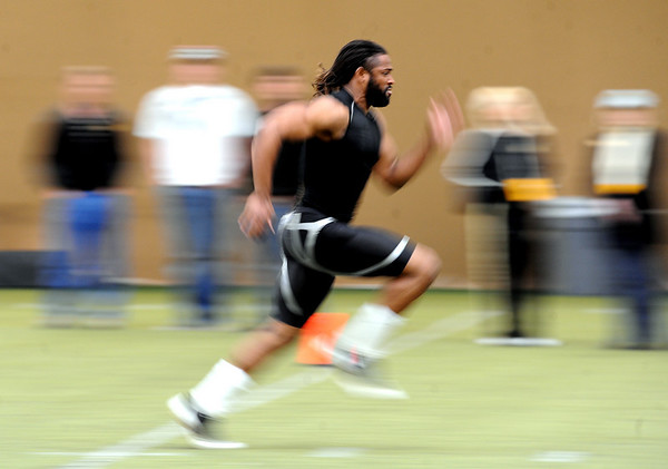 Ben Burney runs one of his 40-yard dashes for the scouts.<br /> University of Colorado football players eligible for the NFL Draft showed their skills during  pro-timing day on campus  on Wednesday.<br /> Cliff Grassmick / March 10, 2010