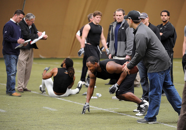Marcus Burton prepares to run a drill for the NFL scouts.<br /> University of Colorado football players eligible for the NFL Draft showed their skills during  pro-timing day on campus  on Wednesday.<br /> Cliff Grassmick / March 10, 2010