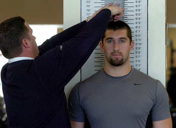 Riar Geer gets measured by the scouts.<br /> University of Colorado football players eligible for the NFL Draft showed their skills during  pro-timing day on campus  on Wednesday.<br /> Cliff Grassmick / March 10, 2010