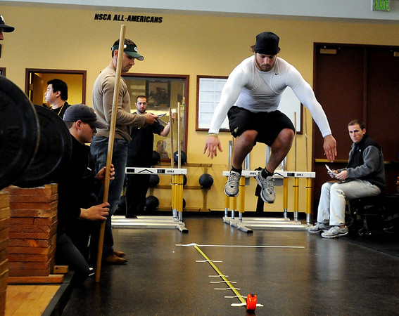 Jeff Smart attempts a standing long jump for the scouts.<br /> University of Colorado football players eligible for the NFL Draft showed their skills during  pro-timing day on campus  on Wednesday.<br /> Cliff Grassmick / March 10, 2010