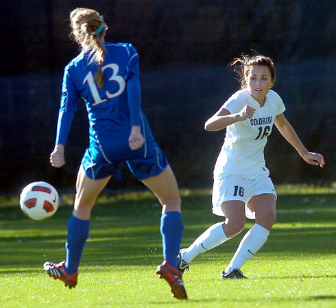 University of Colorado's #16 Amanda Foulk passes the ball around #13 Caitlin Noble during the game against the Kansas Jaywaks  on  October 25, 2010 in Boulder.<br /> Photo by Paul Aiken