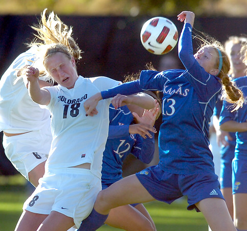 University of Colorado's #18 Lizzy Herzl  fights for a head on a corner kick against #13 Caitlin Noble during the game against the Kansas Jaywaks  on  October 25, 2010 in Boulder.<br /> Photo by Paul Aiken