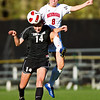 S1030SOCCER1<br /> CU's #14, Taryn Vitacca heads the ball as Nebraska's #8 Molly Thomas, flies to intercept during CU's 2-1 victory.<br /> <br /> Photo by: Jonathan Castner