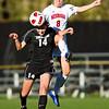 S1030SOCCER1<br /> CU's #14, Taryn Vitacca heads the ball as Nebraska's #8 Molly Thomas, flies to intercept during CU's 2-1 victory.<br /> <br /> Photo by: Jonathan Castner