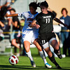 S1030SOCCER3<br /> CU's #11, Erin Bricker drives to the goal as Nebraska's #23, Brittany Goosen defends during CU's 2-1 victory. The drive ended in a goal by Bricker.<br /> <br /> Photo by: Jonathan Castner