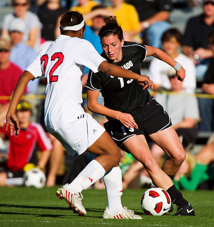 S1030SOCCER6<br /> CU's #13, Kate Russell works the ball against Nebraska's #22, Maritza Hayes, during CU's 2-1 victory.<br /> <br /> Photo by: Jonathan Castner