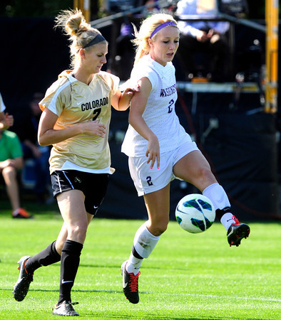 "University of Colorado Women's Team Soccer Player Shaye Marshall (7) battles for the ball against Washington's Isabel Farrell (2) during their game in Boulder on Friday September 28, 2012. Photo by Paul Aiken /   <a href=""http://www.buffzone.com"">http://www.buffzone.com</a>"