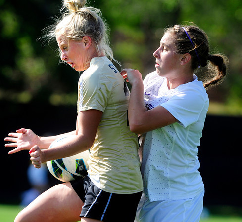 "University of Colorado Womens Team Soccer Player Anne Stuller (23) traps the ball in front of Washington's (25) Molly Boyd during their game in Boulder on Friday September 28, 2012. Photo by Paul Aiken /   <a href=""http://www.buffzone.com"">http://www.buffzone.com</a>"