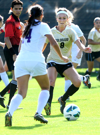 """University of Colorado Womens Team Soccer Player Darcy Jerman (9) defends against Washington's Christina Archer (14) during their game in Boulder on Friday September 28, 2012. Photo by Paul Aiken /   <a href=""""http://www.buffzone.com"""">http://www.buffzone.com</a>"""