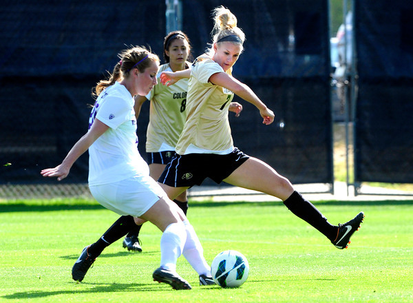 """University of Colorado Women's Team Soccer Player Shaye Marshall (7) defends against Washington's Annie Sittauer (20) during their game in Boulder on Friday September 28, 2012. Photo by Paul Aiken /   <a href=""""http://www.buffzone.com"""">http://www.buffzone.com</a>"""