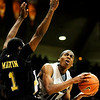 Colorado Buffalo's Alec Burks (10) shoots shoots around Arkansas-Pine Bluff's Vincent Martin  (1) during the season opener at the Coors Even Center in Boulder, Friday, Nov. 13, 2009. <br /> <br /> KASIA BROUSSALIAN / THE CAMERA
