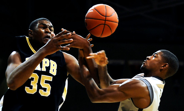 Colorado Buffalo's Cory Higgins (11) attempts to maintain possession of the ball as Arkansas-Pine Bluff's Lebaron Weathers defends during the season opener at the Coors Even Center in Boulder, Friday, Nov. 13, 2009. <br /> <br /> KASIA BROUSSALIAN / THE CAMERA