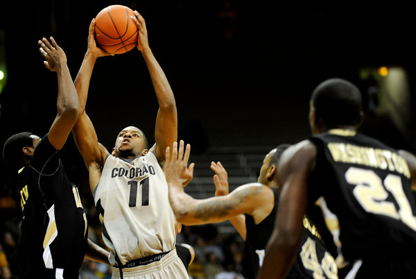 Colorado Buffalo's Cory Higgins (11) shoots over Arkansas-Pine Bluff's Tyree Glass (44) and Vincent Martin (1) during the season opener at the Coors Even Center in Boulder, Friday, Nov. 13, 2009. <br /> <br /> KASIA BROUSSALIAN / THE CAMERA