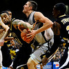 Colorado Buffalo's Austin Dufault (33) is fowled by Arkansas-Pine Bluff's Tyree Glass (44) during the season opener at the Coors Even Center in Boulder, Friday, Nov. 13, 2009. <br /> <br /> KASIA BROUSSALIAN / THE CAMERA