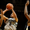 Colorado Buffalo's Marcus Relphorde (5) shoots over Arkansas-Pine Bluff's Tyree Glass (44) and Lebaron Weathers during the season opener at the Coors Even Center in Boulder, Friday, Nov. 13, 2009. <br /> <br /> KASIA BROUSSALIAN / THE CAMERA
