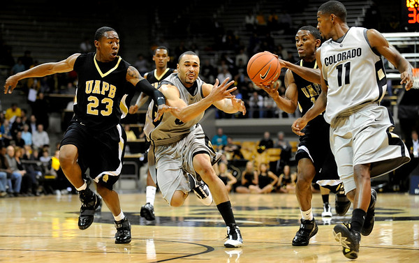 Colorado Buffalo's Marcus Relphorde (5) misses a pass to Cory Higgins (11) as Arkansas-Pine Bluff's Terrance Calvin (14) picks it up and Savalace Townsend (23) defends during the season opener at the Coors Even Center in Boulder, Friday, Nov. 13, 2009. <br /> <br /> KASIA BROUSSALIAN / THE CAMERA