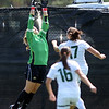 "CU keeper, Annie Brunner, goes up high to stop a shot by Emily Reddington of Wright State.<br /> For more photos of the game, go to  <a href=""http://www.dailycamera.com"">http://www.dailycamera.com</a>.<br /> Cliff Grassmick  / August 26, 2012"