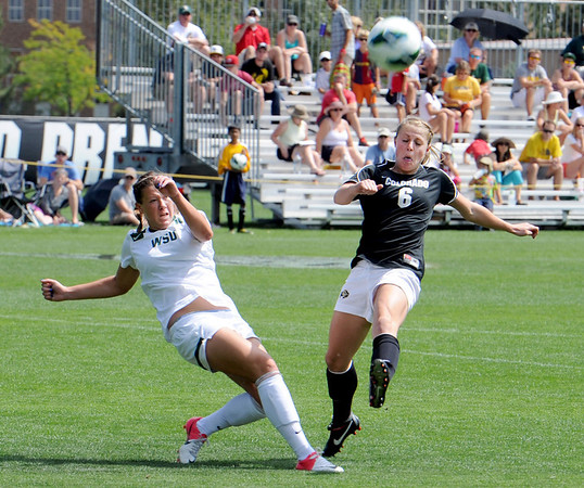 "Allie Metzler, left, of Wright State, kicks the ball from Hayley Hughes of CU.<br /> For more photos of the game, go to  <a href=""http://www.dailycamera.com"">http://www.dailycamera.com</a>.<br /> Cliff Grassmick  / August 26, 2012"