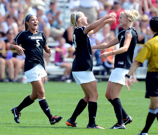 """Olivia Pappalardo, left, and Shaye Marshall, right, congratulate Anne Stuller on her goal against WSU.<br /> For more photos of the game, go to  <a href=""""http://www.dailycamera.com"""">http://www.dailycamera.com</a>.<br /> Cliff Grassmick  / August 26, 2012"""