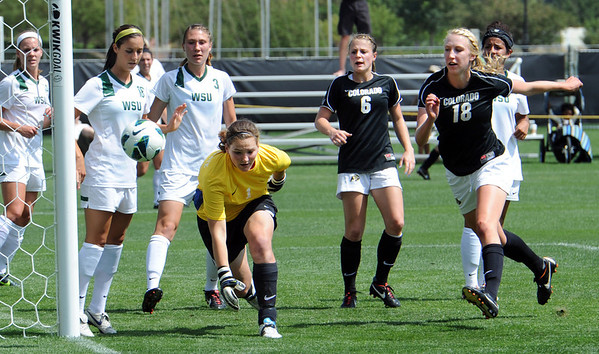 """Lizzy Herzl (18) of CU, charges the net trying to score past keeper, Brooke McCurdy of WSU.<br /> For more photos of the game, go to  <a href=""""http://www.dailycamera.com"""">http://www.dailycamera.com</a>.<br /> Cliff Grassmick  / August 26, 2012"""