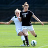 "Erin Bricker (11) of CU kicks the ball away from Kalee Thompson of Wright State.<br /> For more photos of the game, go to  <a href=""http://www.dailycamera.com"">http://www.dailycamera.com</a>.<br /> Cliff Grassmick  / August 26, 2012"