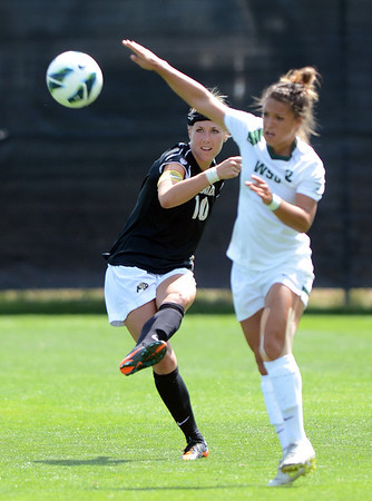"Amy Barczuk of CU kicks the ball away from the Wright State defender.<br /> For more photos of the game, go to  <a href=""http://www.dailycamera.com"">http://www.dailycamera.com</a>.<br /> Cliff Grassmick  / August 26, 2012"