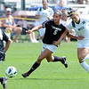 "Olivia Pappalardo (5) of CU runs past Sarah Gross of WSU.<br /> For more photos of the game, go to  <a href=""http://www.dailycamera.com"">http://www.dailycamera.com</a>.<br /> Cliff Grassmick  / August 26, 2012"