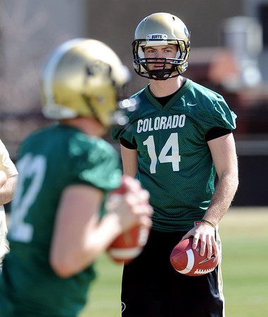 "Quarterback John Schrock works out during the first CU Spring practice on Saturday.<br /> For more photos and videos of practice, go to  <a href=""http://www.dailycamera.com"">http://www.dailycamera.com</a>.<br /> Cliff Grassmick / March 10, 2012"