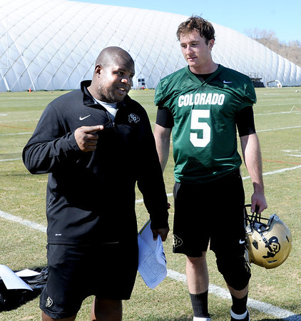 """CU offensive coordinator, Eric Bieniemy, talks with Connor Wood after practice.<br /> For more photos and videos of practice, go to  <a href=""""http://www.dailycamera.com"""">http://www.dailycamera.com</a>.<br /> Cliff Grassmick / March 10, 2012"""
