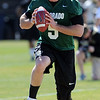 "Quarterback Connor Wood works out during the first CU Spring practice on Saturday.<br /> For more photos and videos of practice, go to  <a href=""http://www.dailycamera.com"">http://www.dailycamera.com</a>.<br /> Cliff Grassmick / March 10, 2012"