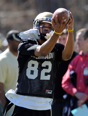 """Jarrod Darden catches a ball during Spring drills.<br /> For more photos and videos of practice, go to  <a href=""""http://www.dailycamera.com"""">http://www.dailycamera.com</a>.<br /> Cliff Grassmick / March 10, 2012"""