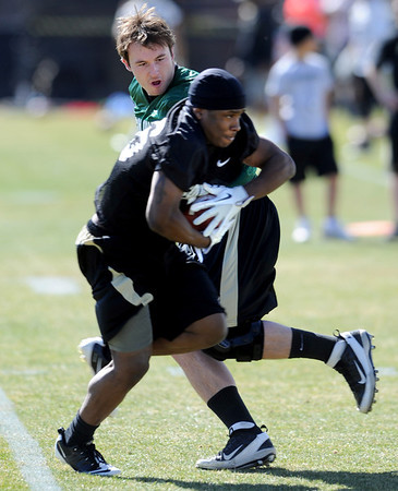 "Connor Wood hands off to Tony Jones during Spring drills.<br /> For more photos and videos of practice, go to  <a href=""http://www.dailycamera.com"">http://www.dailycamera.com</a>.<br /> Cliff Grassmick / March 10, 2012"