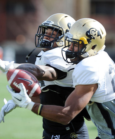 "Paul Vigo, left, and Ray Polk, go through defensive back drills on Sunday.<br /> For more photos and videos of CU football, go to  <a href=""http://www.dailycamera.com"">http://www.dailycamera.com</a>.<br /> Cliff Grassmick / March 18, 2012"