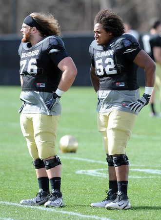 "Gus Handler, left, and Daniel Munyer, watch the O-line on Sunday.<br /> For more photos and videos of CU football, go to  <a href=""http://www.dailycamera.com"">http://www.dailycamera.com</a>.<br /> Cliff Grassmick / March 18, 2012"