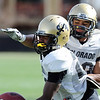 "Harrison Hunter, left, and Greg Henderson, go through defensive back drills on Sunday.<br /> For more photos and videos of CU football, go to  <a href=""http://www.dailycamera.com"">http://www.dailycamera.com</a>.<br /> Cliff Grassmick / March 18, 2012"